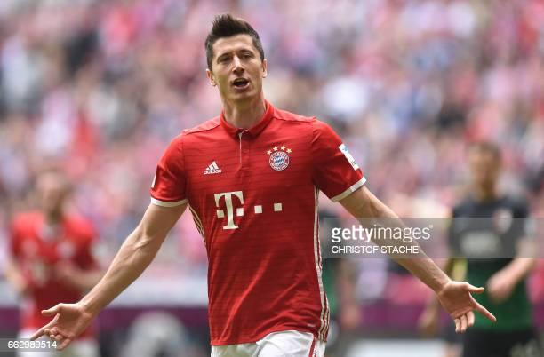 Bayern Munich's Polish striker Robert Lewandowski celebrates after scoring during the German first division Bundesliga football match between Bayern...