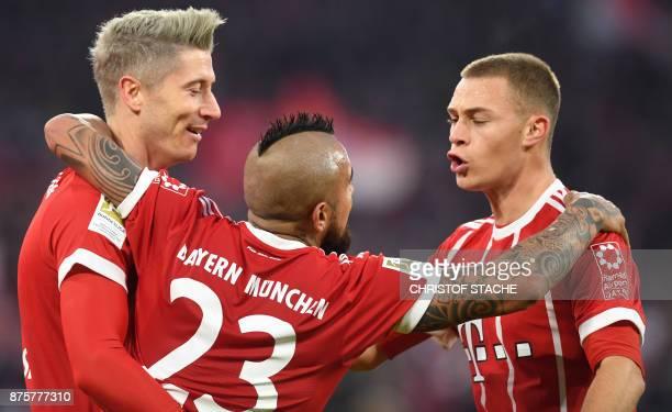 Bayern Munich's Polish striker Robert Lewandowski celebrates after scoring the second goal for Munich with Bayern Munich's Chilean midfielder Arturo...