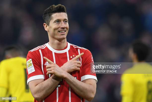 Bayern Munich's Polish striker Robert Lewandowski celebrates after scoring the sixth goal for Munich during the German first division Bundesliga...