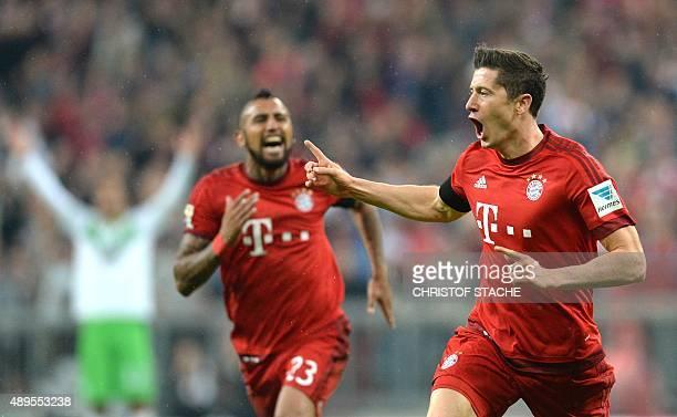 Bayern Munich's Polish striker Robert Lewandowski celebrates after the third goal for Munich during the German first division Bundesliga football...
