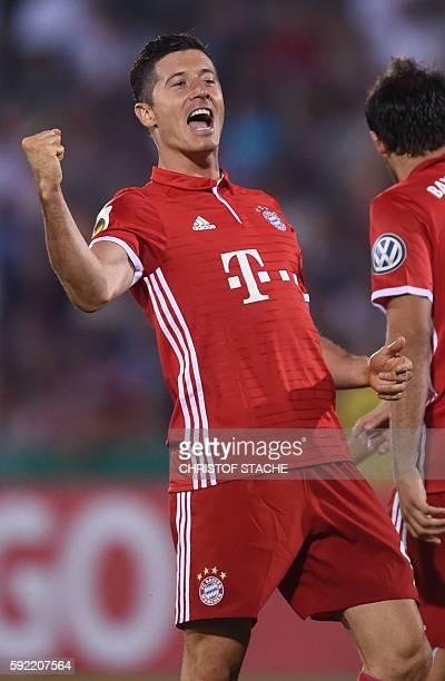 Bayern Munich's Polish striker Robert Lewandowski celebrates after the first goal for Munich during the German Cup first round football match between...