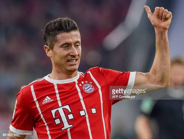 Bayern Munich's Polish striker Robert Lewandowski celebrates during the German First division Bundesliga football match FC Bayern Munich vs VfL...