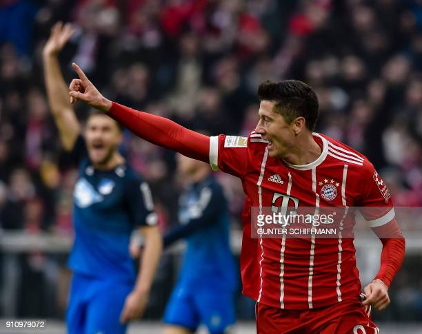 Bayern Munich's Polish striker Robert Lewandowski celebrates his first goal during the German first division Bundesliga football match Bayern Munich...