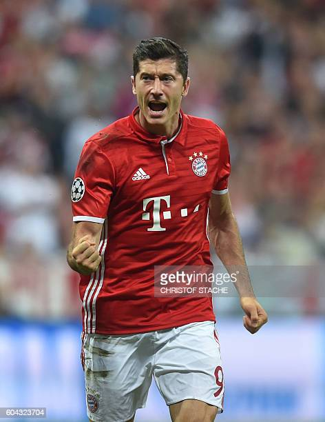Bayern Munich's Polish striker Robert Lewandowski celebrates scoring the opening goal from the penalty spot during the Champions League group D...