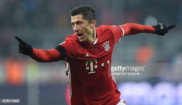 Bayern Munich's Polish striker Robert Lewandowski celebrates scoring the opening goal during the UEFA Champions League group D football match between...