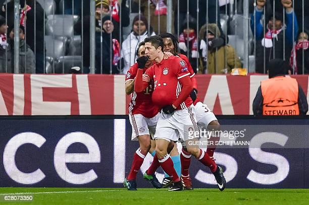 Bayern Munich's Polish striker Robert Lewandowski celebrates scoring the opening goal with his teammates during the UEFA Champions League group D...