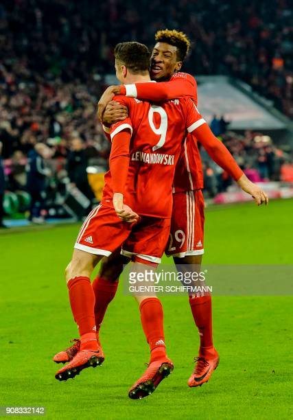 Bayern Munich's Polish striker Robert Lewandowski is congratulated by his teammate after scoring a the third goal during the German first division...