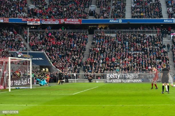 Bayern Munich's Polish striker Robert Lewandowski misses to score a penalty kick during the German first division Bundesliga football match Bayern...