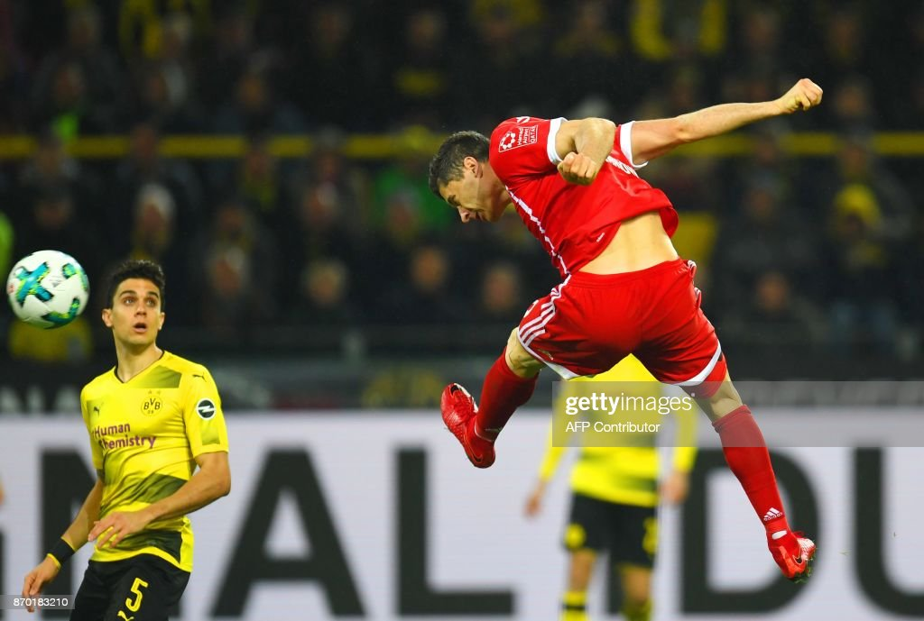 Bayern Munich´s Polish striker Robert Lewandowski plays the ball during the German First division Bundesliga football match Borussia Dortmund vs Bayern Munich in Dortmund, western Germany, on November 4, 2017. /
