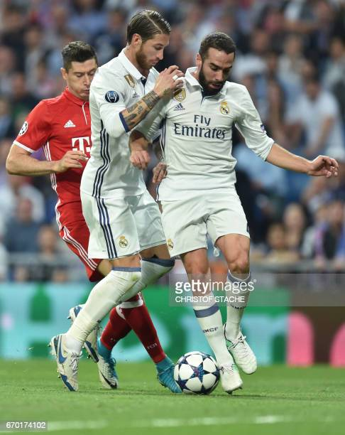 Bayern Munich's Polish striker Robert Lewandowski Real Madrid's defender Sergio Ramos and Real Madrid's defender Dani Carvajal vie for the ball...