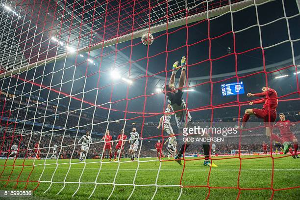 Bayern Munich's Polish striker Robert Lewandowski scores past Juventus' goalkeeper from Italy Gianluigi Buffon during the UEFA Champions League Round...