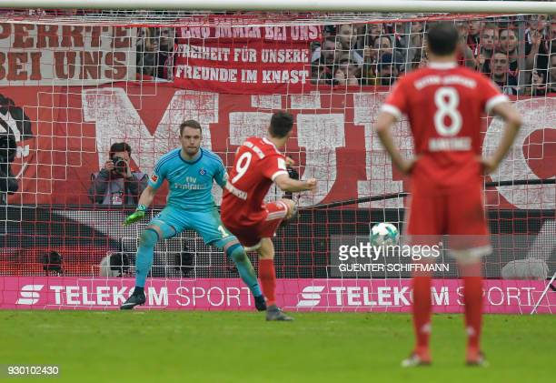 Bayern Munich's Polish striker Robert Lewandowski scores the 60 with a penalty kick during the German first division Bundesliga football match Bayern...
