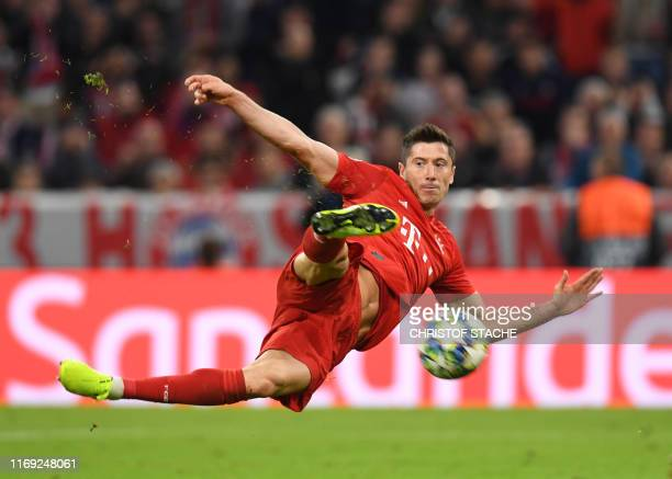Bayern Munich's Polish striker Robert Lewandowski shoots during the UEFA Champions League Group B football match between FC Bayern Munich and Red...