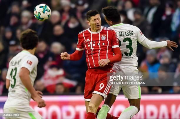 Bayern Munich's Polish striker Robert Lewandowski vies with Bremen's Czech defender Theodor Gerbe Selassie during the German first division...