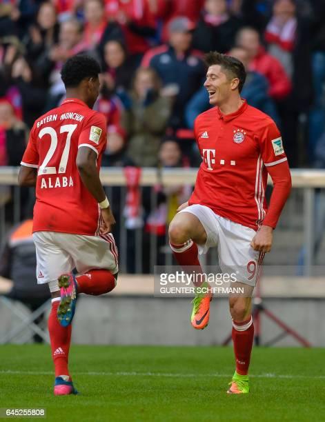 Bayern Munich's Polnish striker Robert Lewandowski and Bayern Munich's Austrian midfielder David Alaba celebrate the third goal during the German...