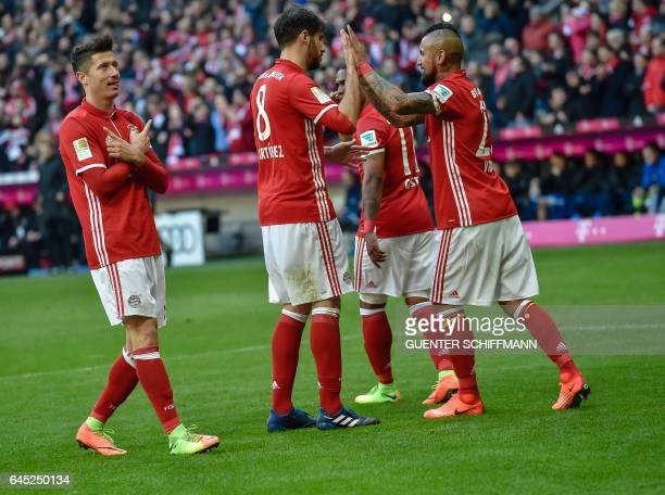 Bayern Munich's Polnish striker Robert Lewandowski celebrates his goal with his teammates during the German first division Bundesliga football match...