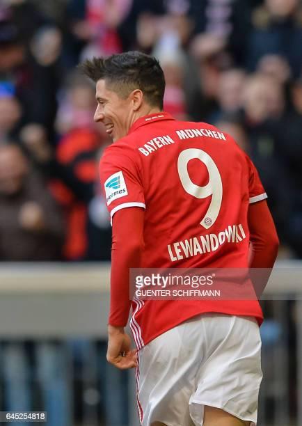 Bayern Munich's Polnish striker Robert Lewandowski celebrates his second goal during the German first division Bundesliga football match between...