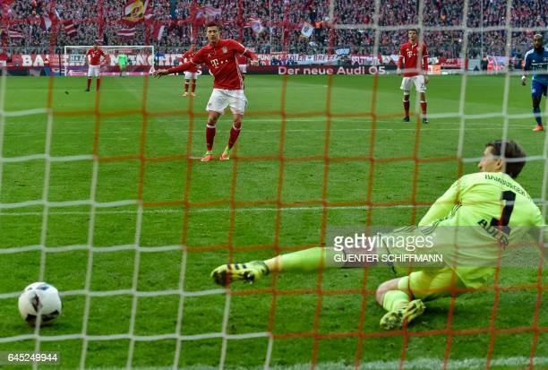 Bayern Munich's Polnish striker Robert Lewandowski scores a penalty during the German first division Bundesliga football match between Bayern Munich...