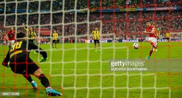 Bayern Munich's Polnish striker Robert Lewandowski scores a penalty during the German first division Bundesliga football match FC Bayern Munich v BVB...