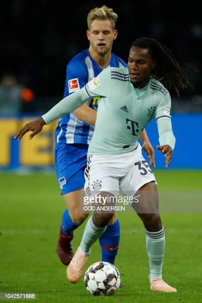 Bayern Munich's Portuguese midfielder Renato Sanches and Berlin's German midfielder Arne Maier vie for the ball during the German first division...