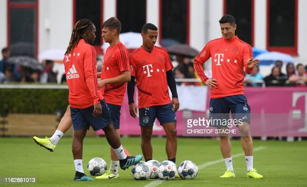 Bayern Munich's Portuguese midfielder Renato Sanches Bayern Munich's German midfielder Joshua Kimmich Bayern Munich's Spanish midfielder Thiago...