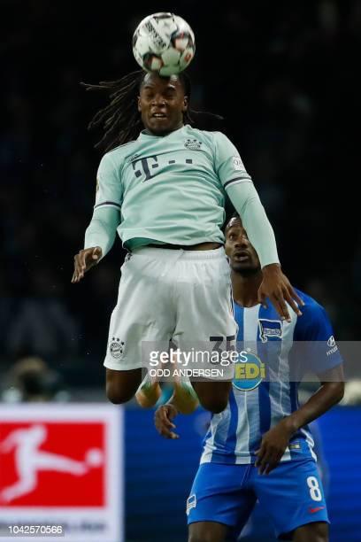 Bayern Munich's Portuguese midfielder Renato Sanches heads the ball in front of Berlin's Ivorian forward Salomon Kalouduring the German first...