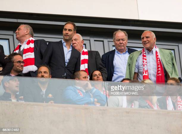 Bayern Munich's President Uli Hoeness and Red Bull founder Dietrich Mateschitz are pictured in the tribune as they watch the German first division...