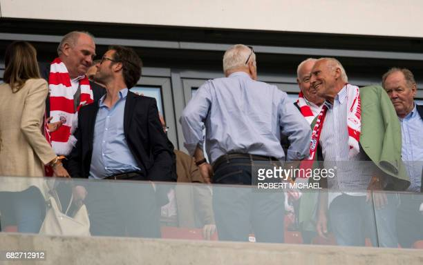 Bayern Munich's President Uli Hoeness and Red Bull founder Dietrich Mateschitz look on at the tribune prior to the German first division Bundesliga...
