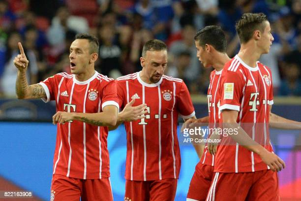 Bayern Munich's Rafinha celebrates his goal during the International Champions Cup football match between Chelsea and Bayern Munich in Singapore on...