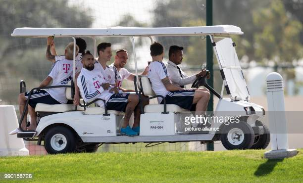 Bayern Munich's Rafinha James Rodriguez Arturo Vidal Marco Friedl Franck Ribery and Javi Martinez drive a car on the court during a training session...