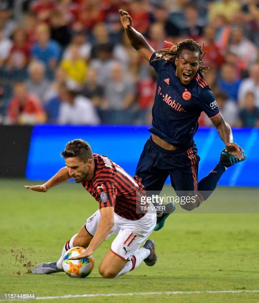 Bayern Munich's Renato Sanches and Milan's Fabio Borini collide and fall during the International Champions Cup football match between Fc Bayern and...