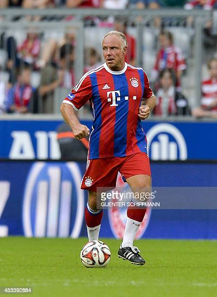 Bayern Munich's retired forward Michael Rummenigge plays the ball during an AllStar game of the FC Bayern AllStars vs the Manchester United Legends...