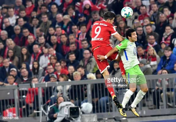 Bayern Munich's Robert Lewandowski and VfL Wolfsburg's William vie for the ball during the German Bundesliga soccer match between Bayern Munich and...