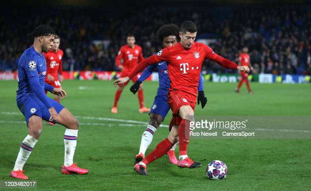 Bayern Munich's Robert Lewandowski holds off Chelsea's Reece James and Willian during the UEFA Champions League round of 16 first leg match between...