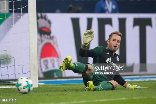 Bayern Munich's Robert Lewandowski scores a goal past Schalke's goalkeeper Ralf Faehrmann during the German Bundesliga soccer match between FC...