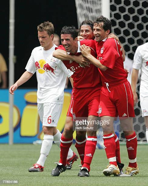 Bayern Munich's Roy Makaay, left, Claudio Pizarro, center, and Bixente Lizarazu, right celebrate after Pizarro scored the second of his two goals as...