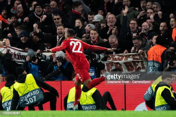 Bayern Munich's Serge Gnabry celebrates scoring his side's first goal in front of away fans during the UEFA Champions League round of 16 first leg...