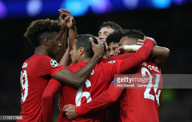 Bayern Munich's Serge Gnabry is congratulated after scoring his side's fourth goal during the UEFA Champions League group B match between Tottenham...