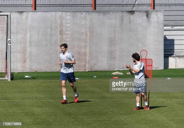 Bayern Munich's Spain defender Alvaro Odriozola gestures with Bayern Munich's Spanish midfielder Javi Martinez attend a training session of the...