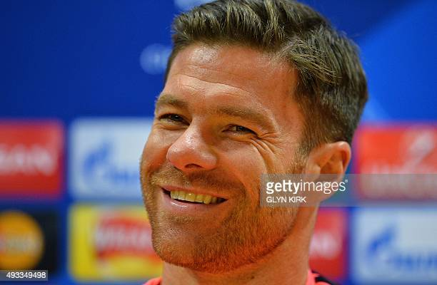 Bayern Munich's Spain defender Xabi Alonso attends a press conference / attends a training session at the Emirates Stadium in London on October 19 on...