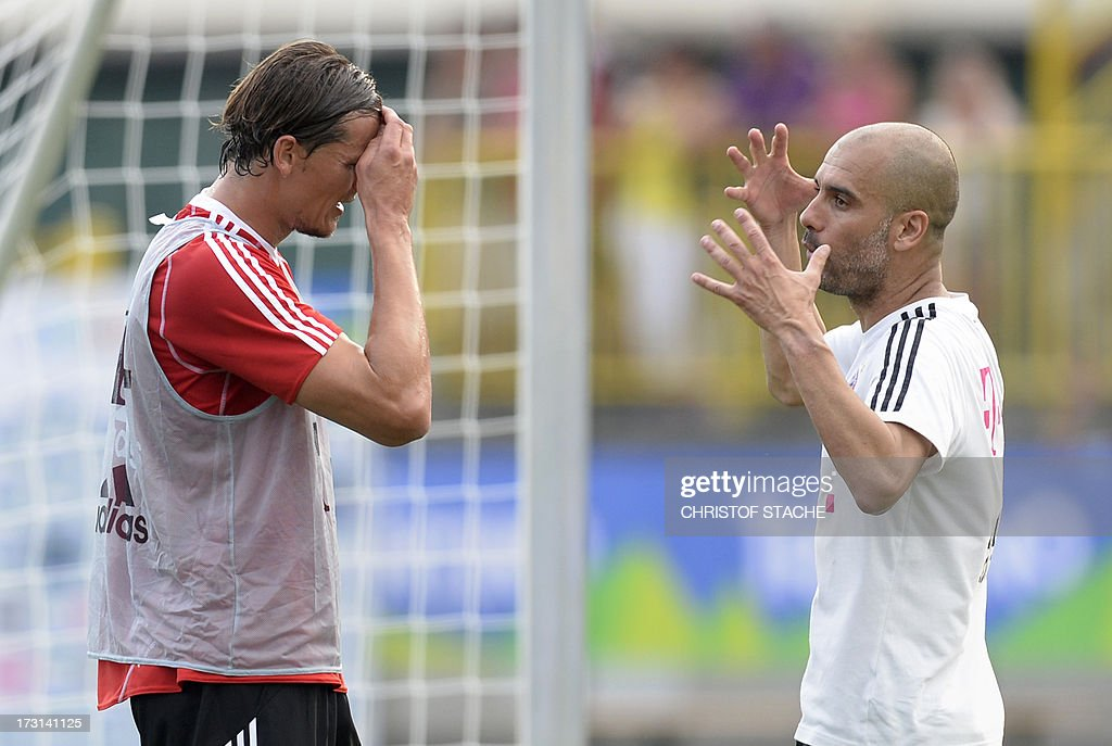 Bayern Munich's Spainish headcoach Pep Guardiola (R) and Bayern Munich's Belgian defender Daniel van Buyten take part in a training session at the FC Bayern Munich team training camp in Arco, Itlay, on July 8, 2013.