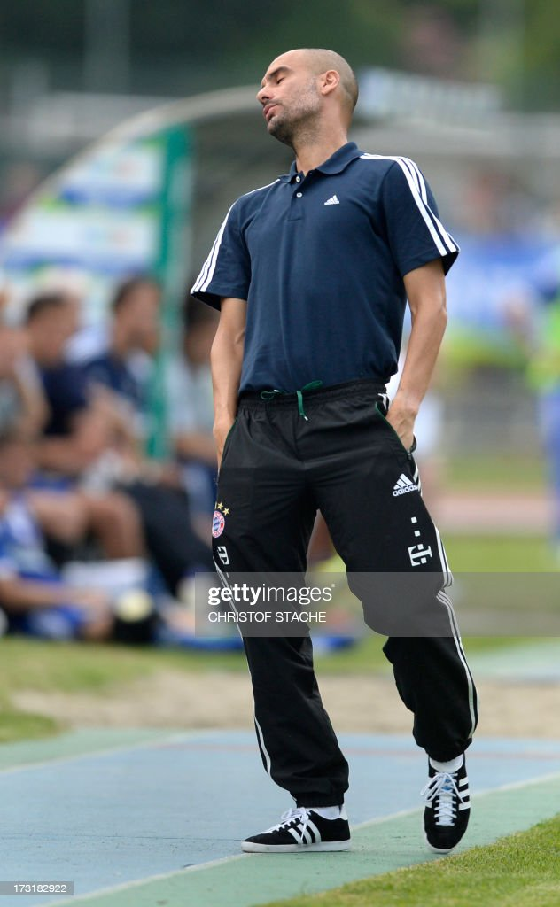 Bayern Munich's Spainish headcoach Pep Guardiola reacts during a test match between FC Bayern Munich and Brescia Calcio in the stadium in Arco, Itlay, on July 9, 2013.