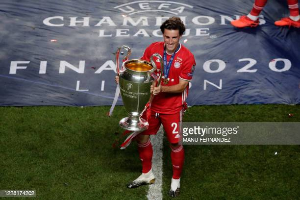 Bayern Munich's Spanish defender Alvaro Odriozola poses with the trophy after Bayern won the UEFA Champions League final football match between Paris...