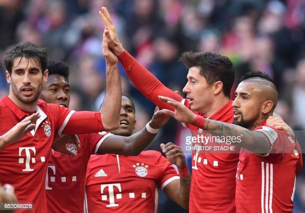 Bayern Munich's Spanish defender Javi Martinez Bayern Munich's Austrian defender David Alaba Bayern Munich's Brazilian midfielder Douglas Costa...
