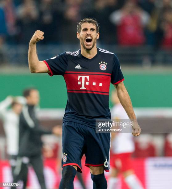 Bayern Munich's Spanish defender Javi Martinez celebrates after winning a penalty shoot out during the German Cup football match RB Leipzig v FC...