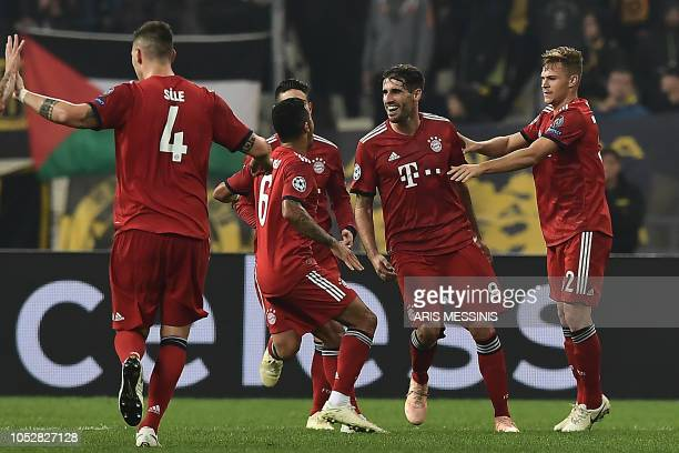 Bayern Munich's Spanish defender Javi Martinez celebrates with teammates after scoring the opener during the UEFA Champions League football match...