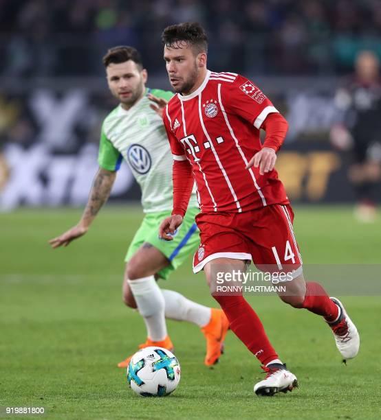 Bayern Munich's Spanish defender Juan Bernat competes with Wolfsburg's Swiss midfielder Renato Steffen during the German first division Bundesliga...