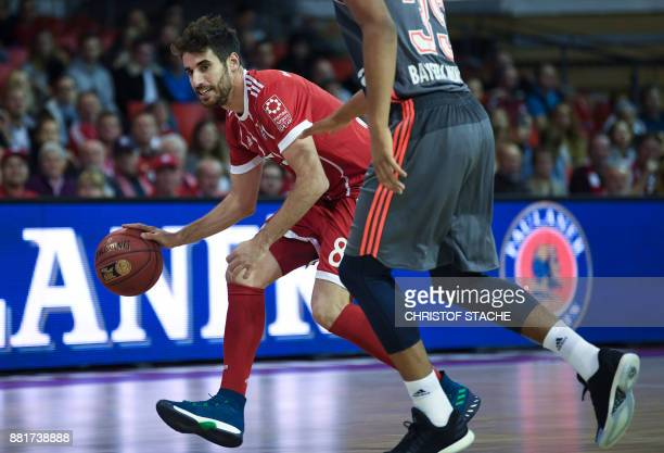 Bayern Munich's Spanish football defender Javi Martinez plays the ball during a basketball match at a sponsor fan event in Munich southern Germany on...