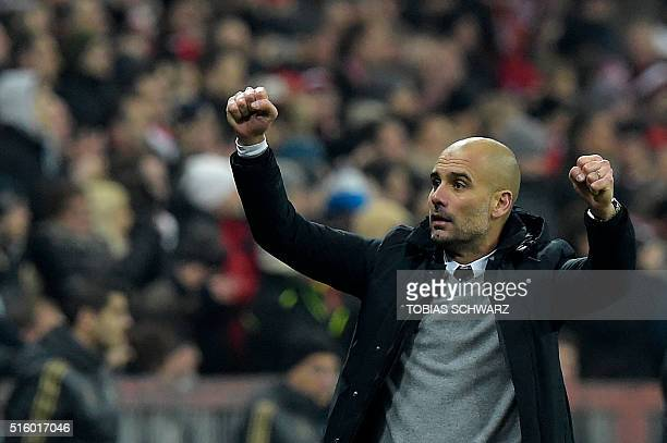 Bayern Munich's Spanish head coach Pep Guardiola celebrates his team's victory after the extra time of the UEFA Champions League Round of 16 second...