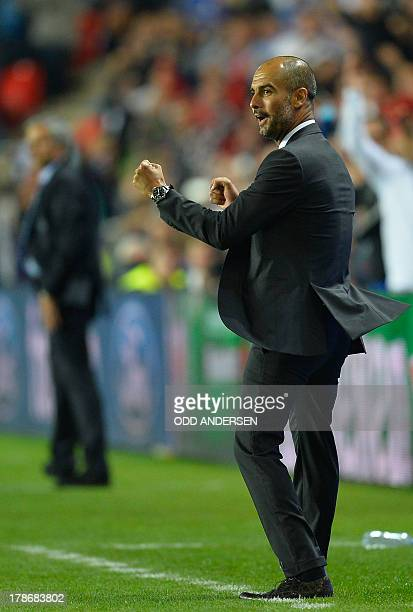 Bayern Munich's Spanish head coach Pep Guardiola celebrates infront of Chelsea's Portuguese manager Jose Mourinho during the UEFA Super Cup football...